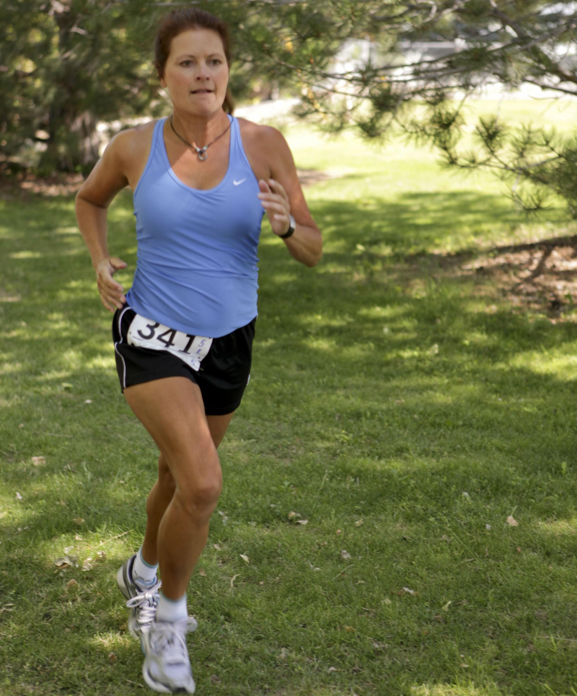 Julie Ellis, PT, SCS running a race