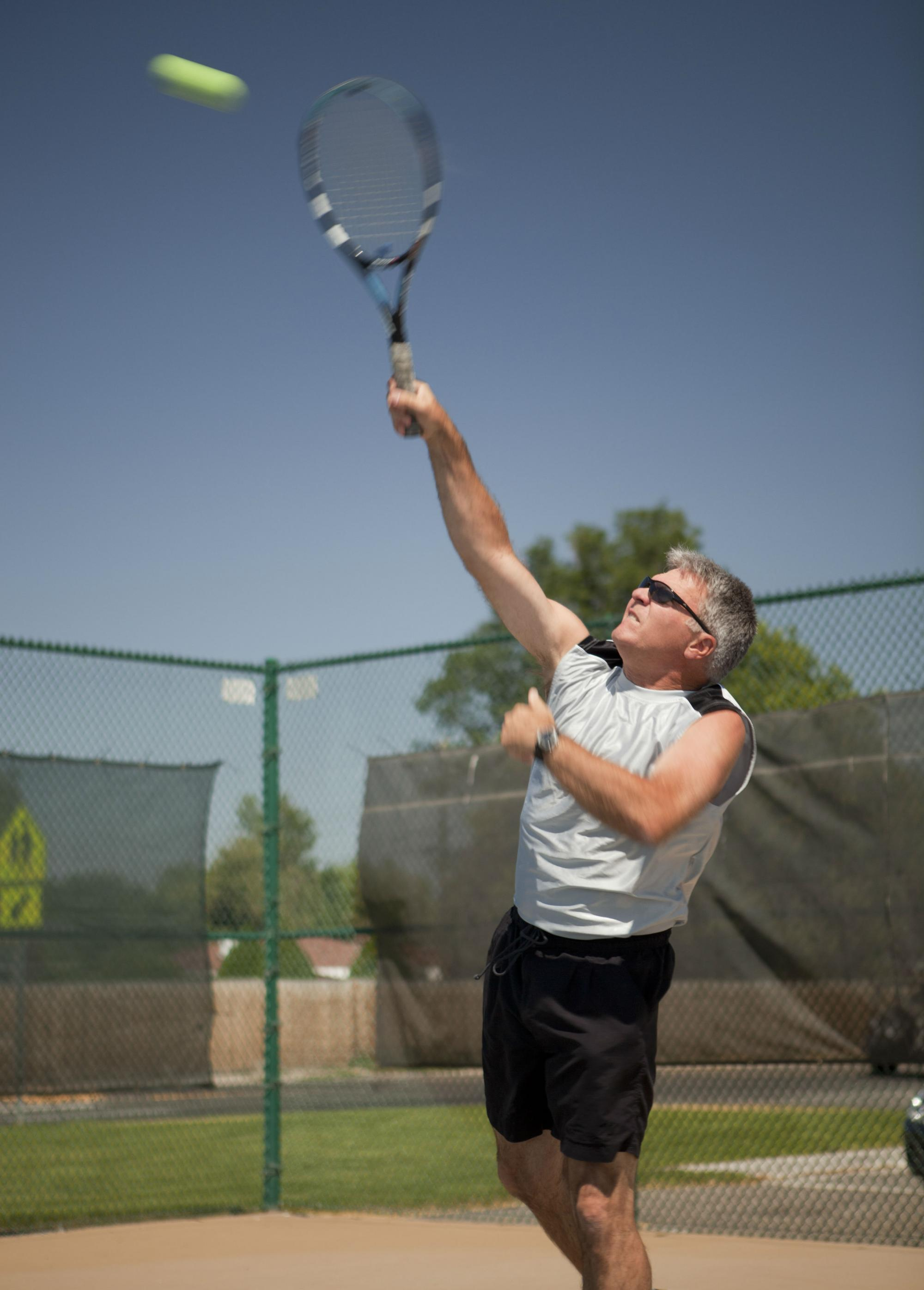 Tom Wagner, retired PT playing tennis