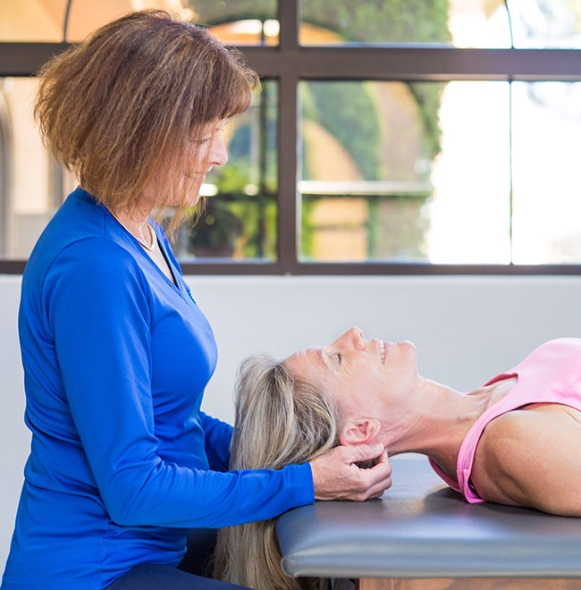 Julie Ellis, PT, SCS performing manual therapy